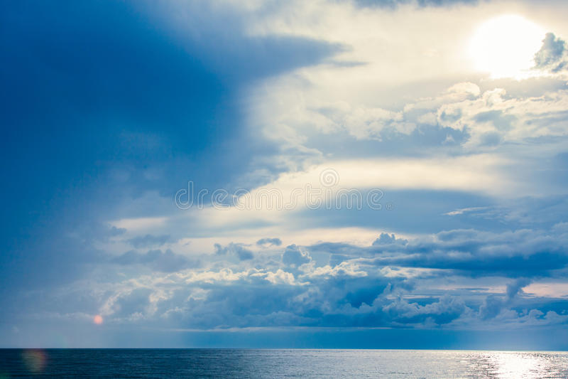 Rain Clouds at the Sea Horizon. In the late afternoon royalty free stock photos