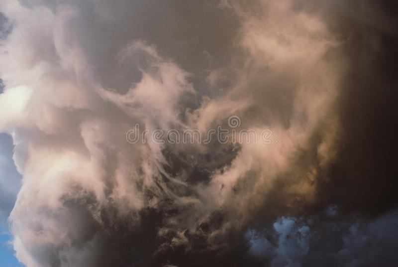 Rain clouds before the storm. Thunderclouds before the storm. Rain clouds. Background symbolizing the power of the elements stock photography