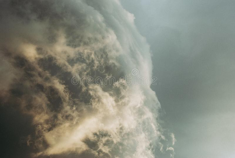 Rain clouds before the storm. Thunderclouds before the storm. Rain clouds. Background symbolizing the power of the elements royalty free stock image