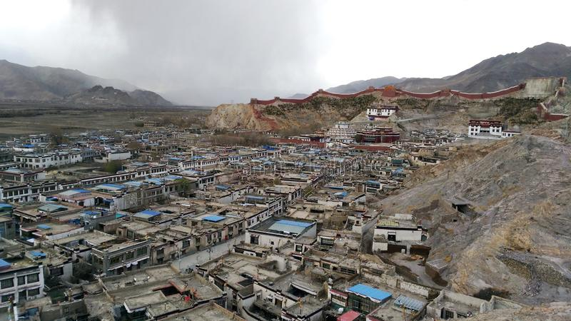 Rain comes. Asia travel, Tibet, Buddhism, top view of the picturesque town of Gyantse stock image