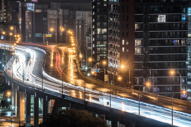 Rain comes down on urban lighted expressway in Toronto, Ontario Canada. stock images