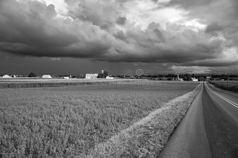 Stormy Sky. Rain in the distance and storm clouds approaching royalty free stock photo