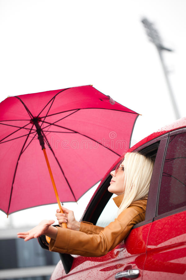 Rain Down On Me - Woman And Her New Car royalty free stock photo