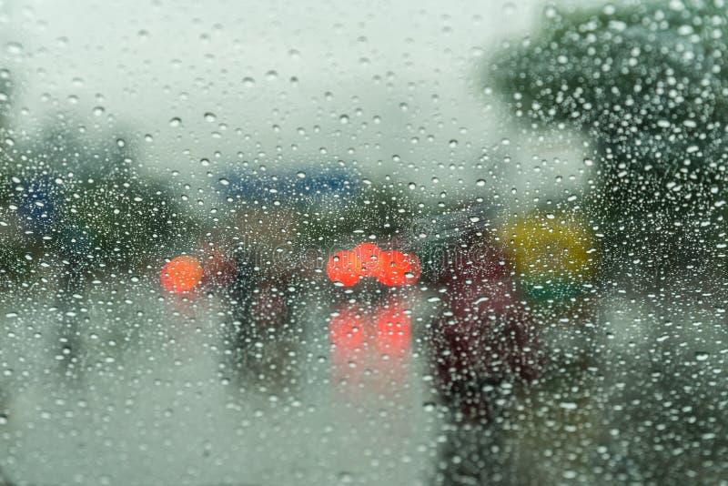 Rain Drop on car windshield. Abstract backgroud with real life rain drops from car windshield on heavy traffic lights royalty free stock photos