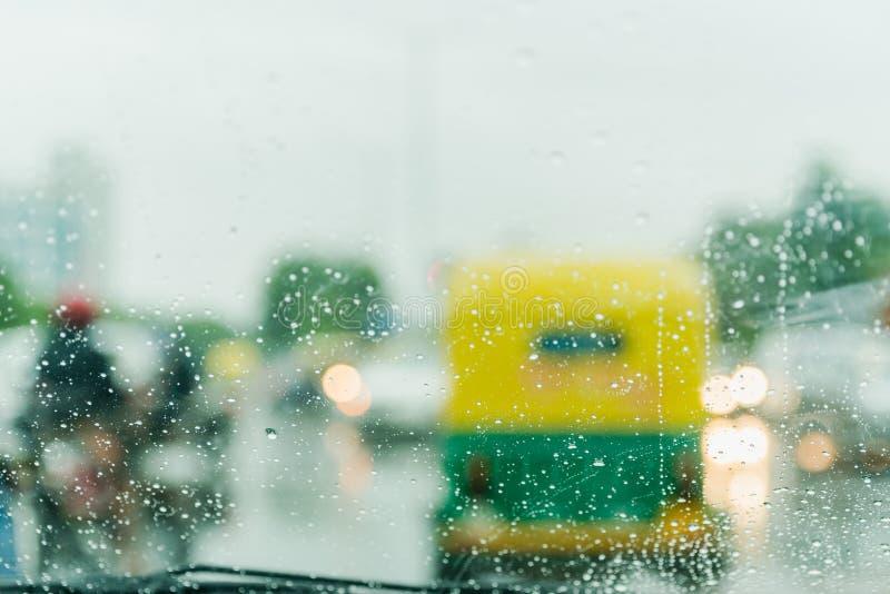 Rain Drop on car windshield. Abstract backgroud with real life rain drops from car windshield on heavy traffic lights stock photos