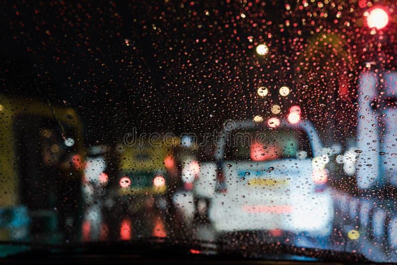 Rain Drop on car windshield. Rain drops from car windshield on heavy traffic lights stock photo