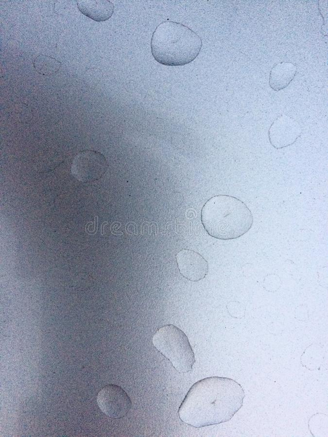 RAIN DROP ON SILVER SURFACE stock photos