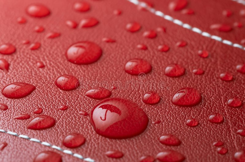 Rain drops. On red leather with umbrella reflection royalty free illustration