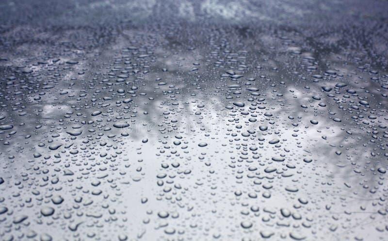 Rain drops on a car low royalty free stock photo