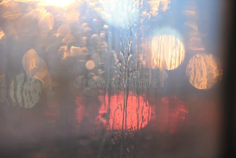 Rain drops, car mirrors, reflections, night lights royalty free stock image