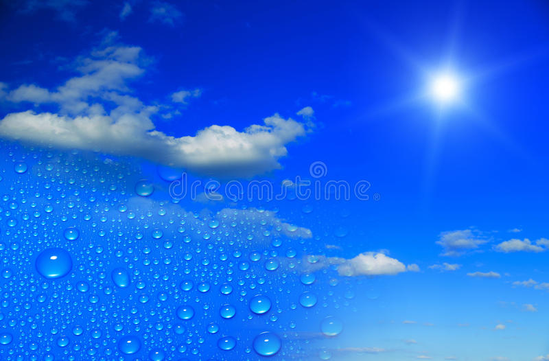 Rain drops clouds and sunny sky. Rain drops clouds on a sunny sky stock image
