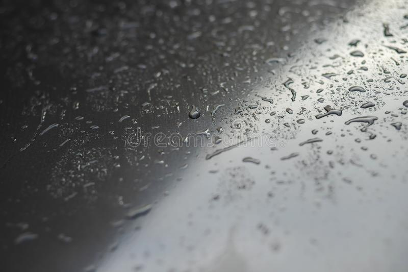 Rain drops and dew. water drops on a gray car roof after stopped raining , selective focus waterproof surface. Soft focus. Leave space for writing text stock photography