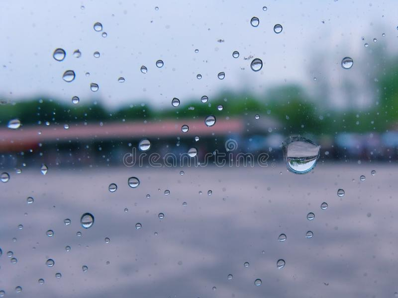 Rain drops on glass royalty free stock photography