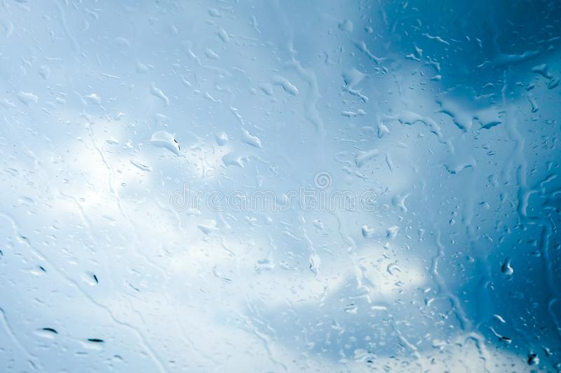 Rain drops on glass, Abstract Background. Sky and clound stock images