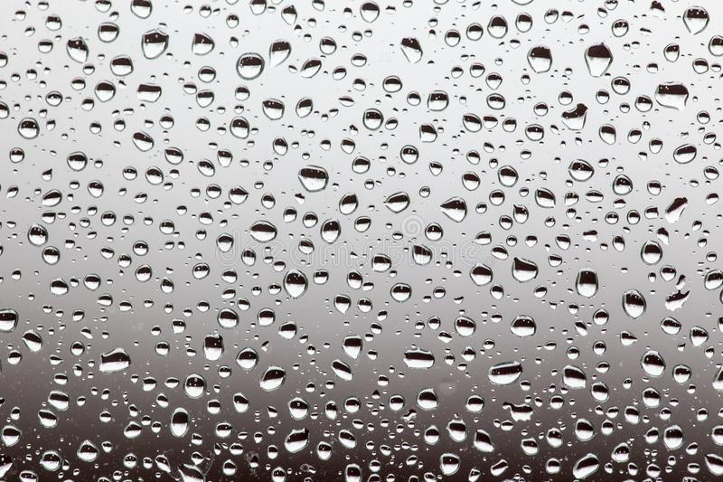 Rain drops on the glass, background. water drop background texture stock photo