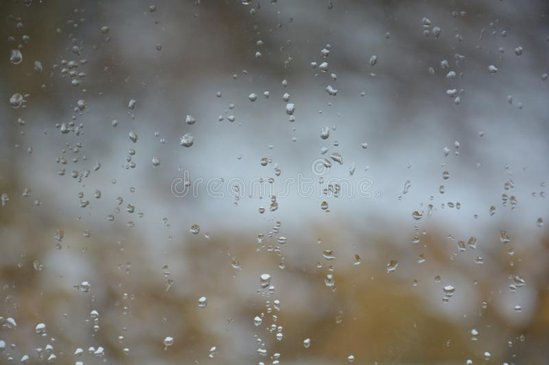Rain drops on the glass. Rain drops glass background water window nature royalty free stock images