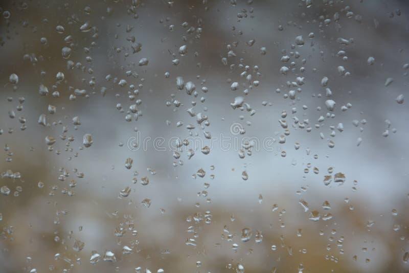 Rain drops on the glass. Rain drops glass background water window nature stock photos