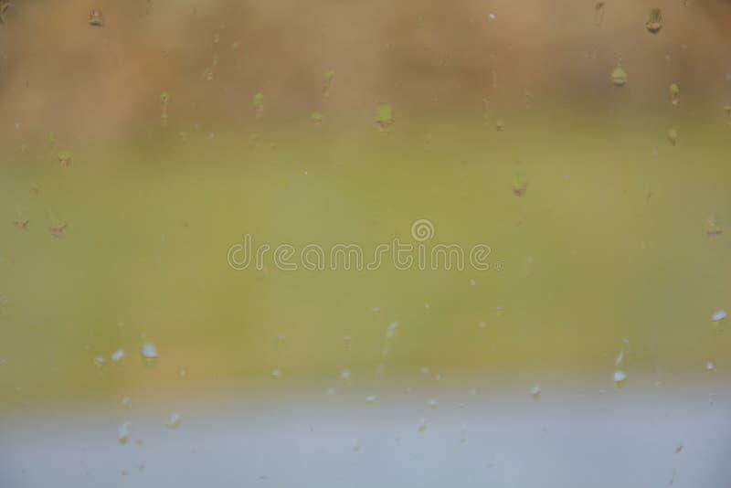 Rain drops on the glass. Rain drops glass background water window nature stock photo