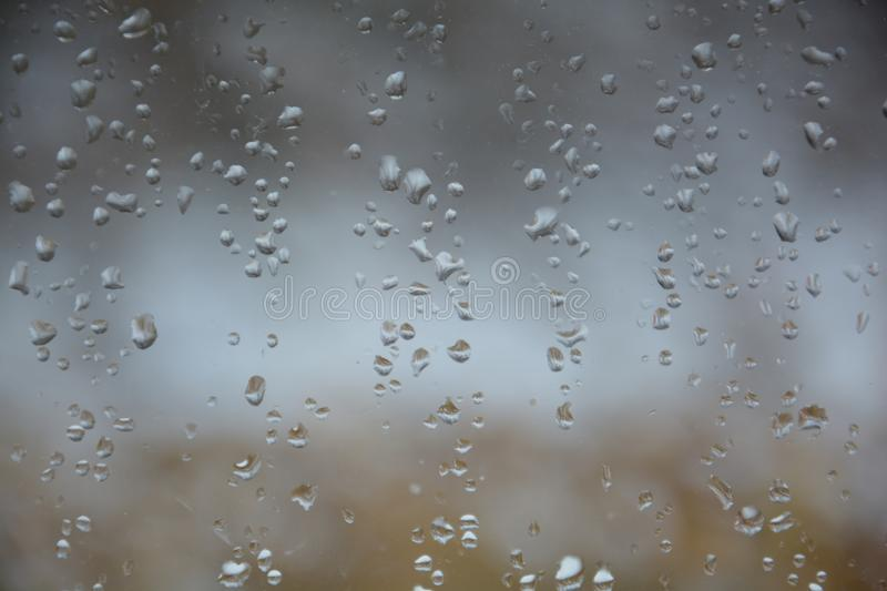 Rain drops on the glass. Rain drops glass background water window nature royalty free stock image