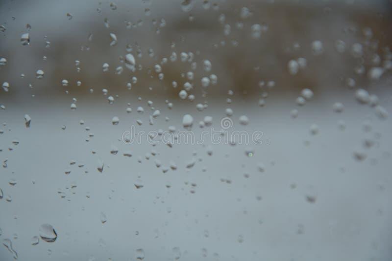 Rain drops on the glass. Rain drops glass background water window nature stock image