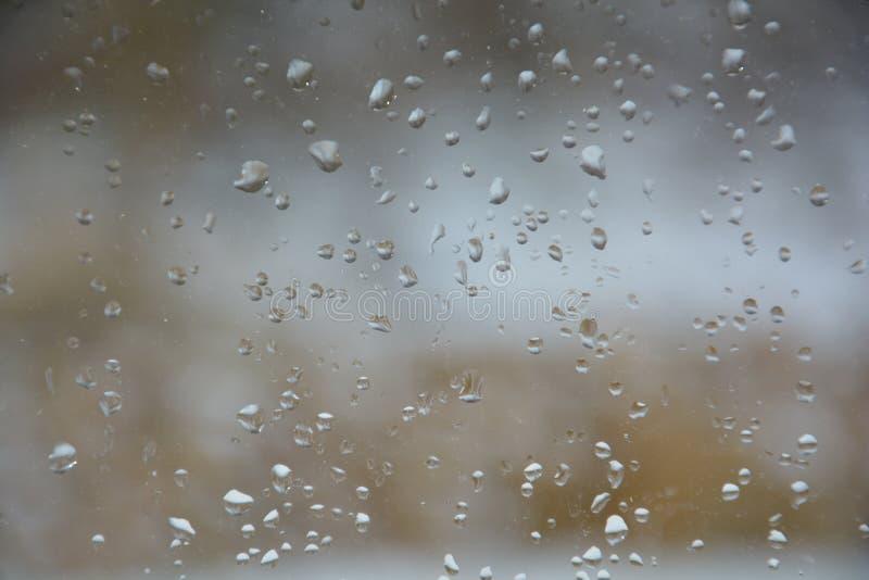Rain drops on the glass. Rain drops glass background water window nature royalty free stock photo