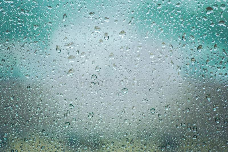 Rain drops on glass clear window close up. Rain drop background stock photography
