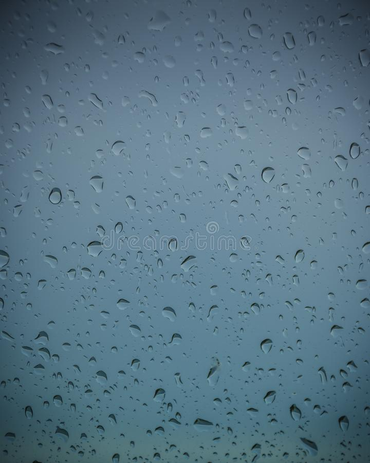 Rain drops on glass with color background.  royalty free stock photos