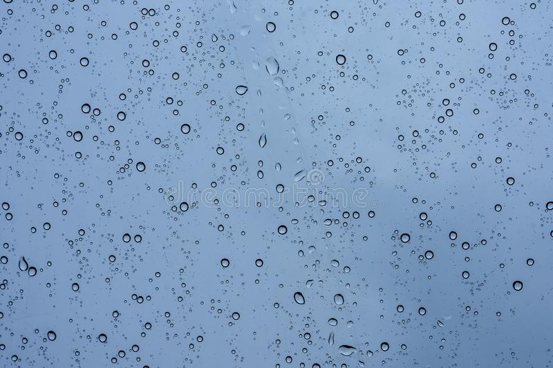 Rain drops on the glass. Rain drops on clear glass royalty free stock photo