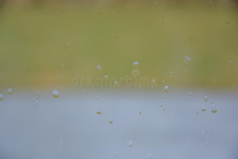 Rain drops on the glass. Rain drops glass background water window nature stock photography