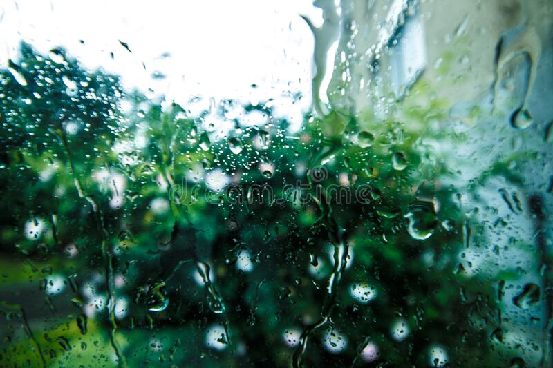 Rain Drops on Glass Surface during Daytime royalty free stock photo