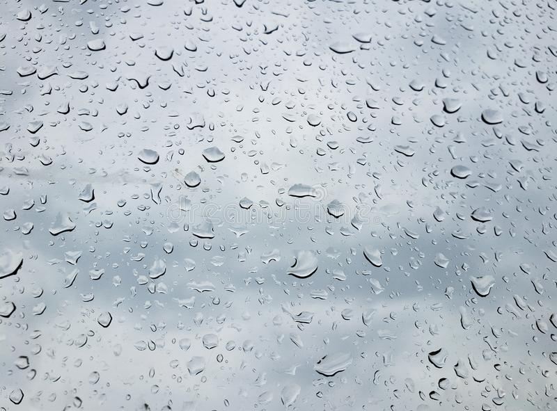 Rain drops on window glasses abstract rain drops on a window royalty free stock images