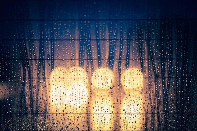 Download Rain Drops On Window With Night Road Light Bokeh Stock Photo