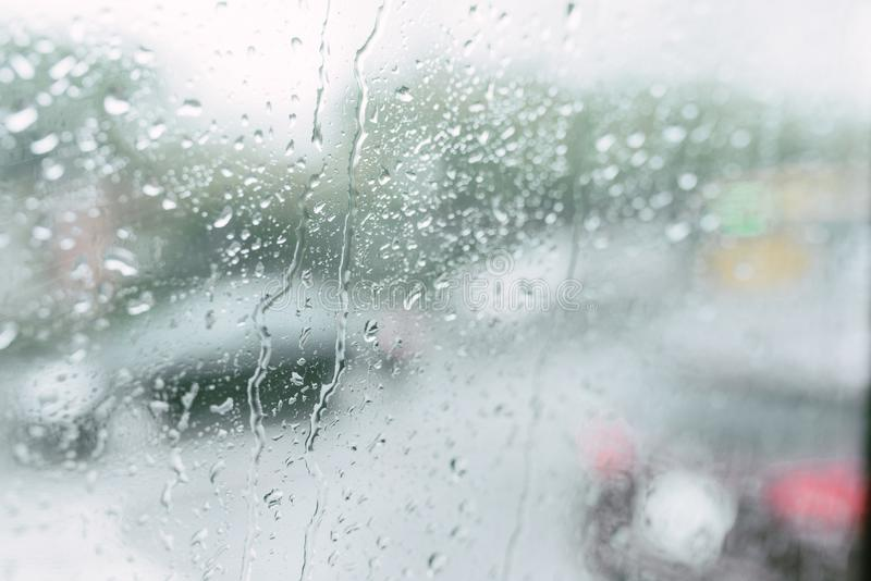 Rain drops on the window on a public bus.Selective focus.  stock photography