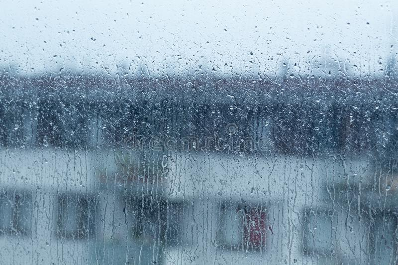 Rain falling outside the window, rainy weather stock image