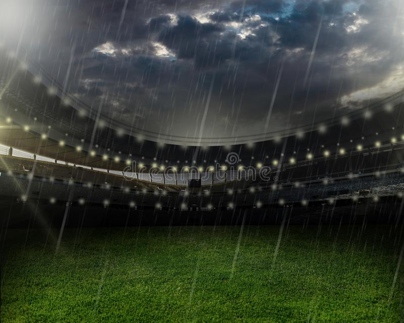 Rain at a football stadium royalty free stock image