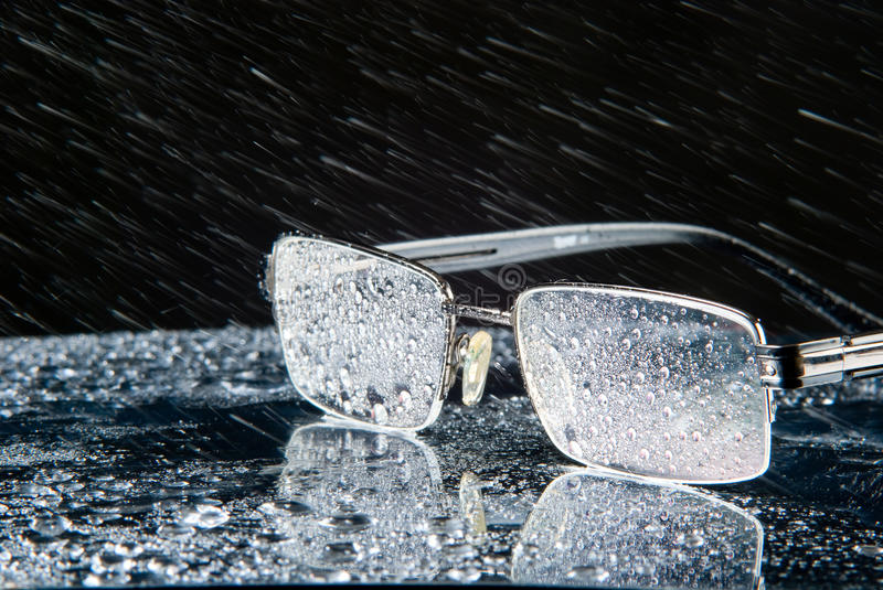 Rain and glasses stock images