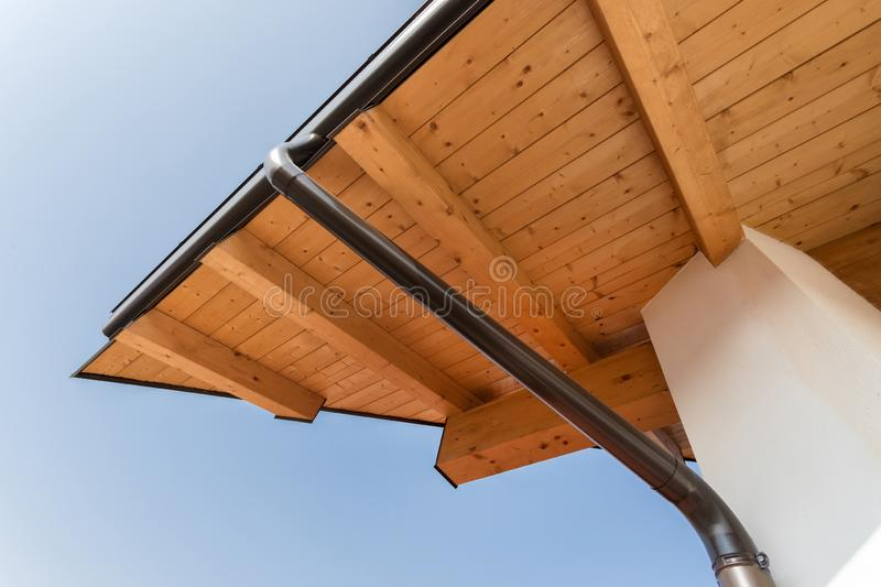 Rain gutter on the roof ecological house stock photos