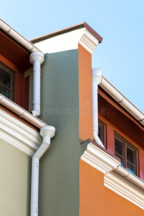 Rain Gutters And Drainpipes On Old Home Stock Photo