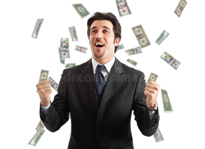 Rain of money. Happy businessman enjoying a rain of money stock photos