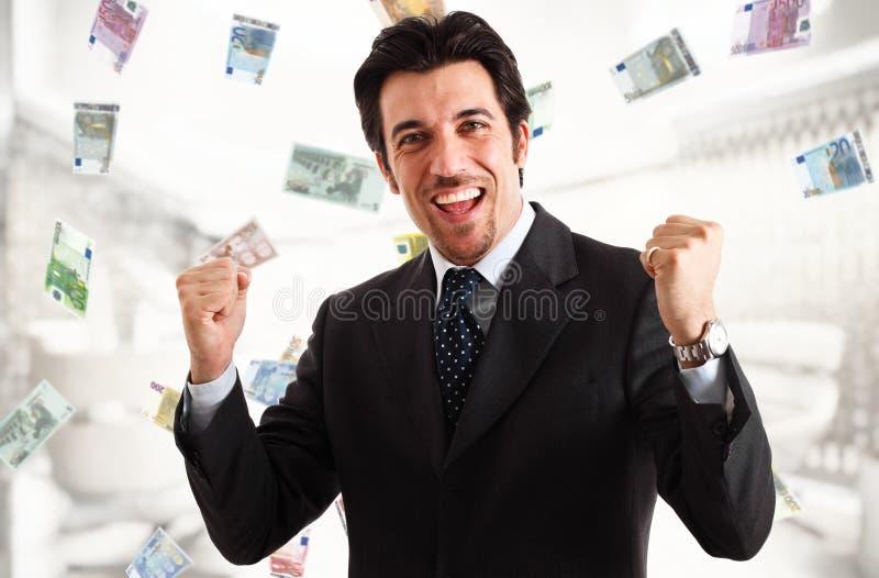 Rain of money. Happy man enjoying a rain of money stock photo