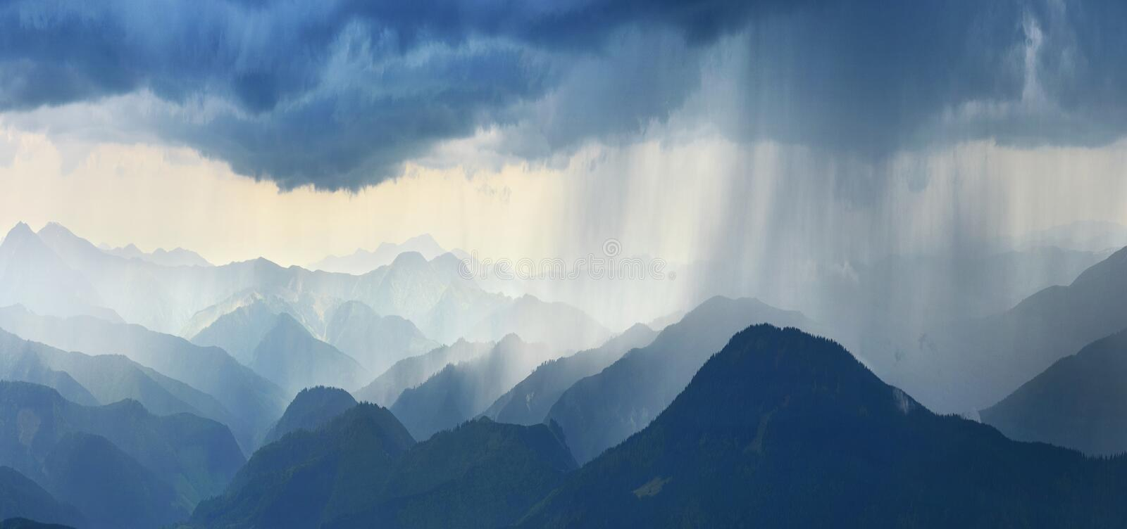Rain in mountains. Heavy rain in spring mountains royalty free stock images