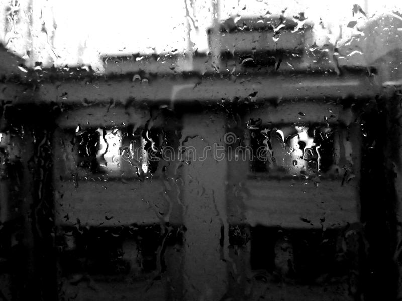 Rain Pouring on Glass Window royalty free stock images