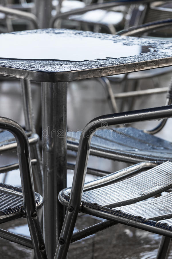 Rain puddle on the table. In a cafe stock photography