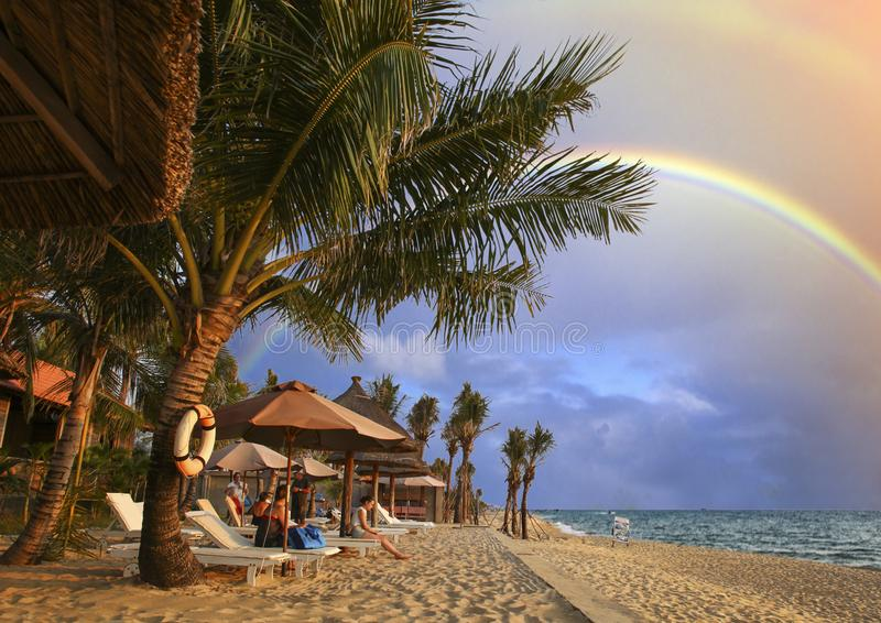 Beautiful sunset on the seaside of Phu Quoc Island in Vietnam. After the rain, rainbows appear on Phu Quoc beach of Vietnam royalty free stock photos
