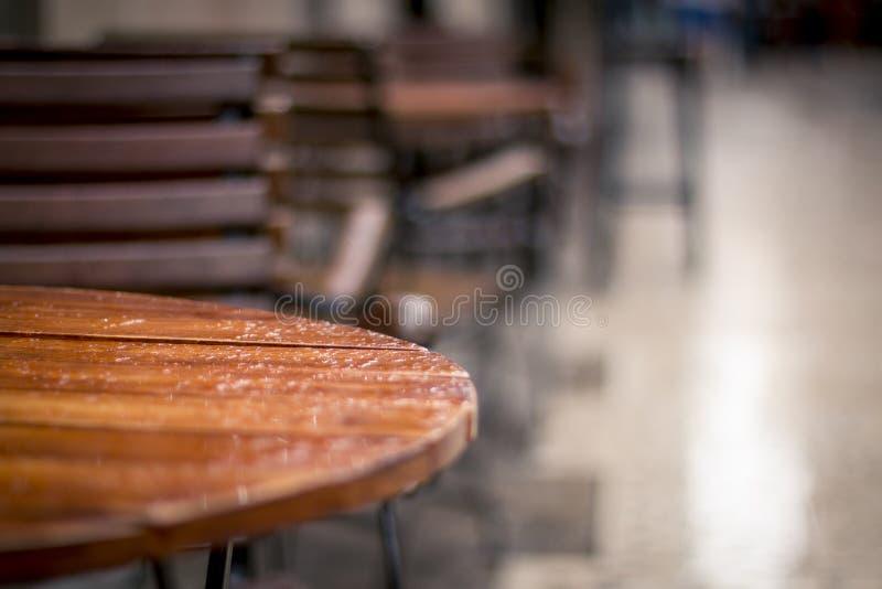 Rain on restaurant table stock images