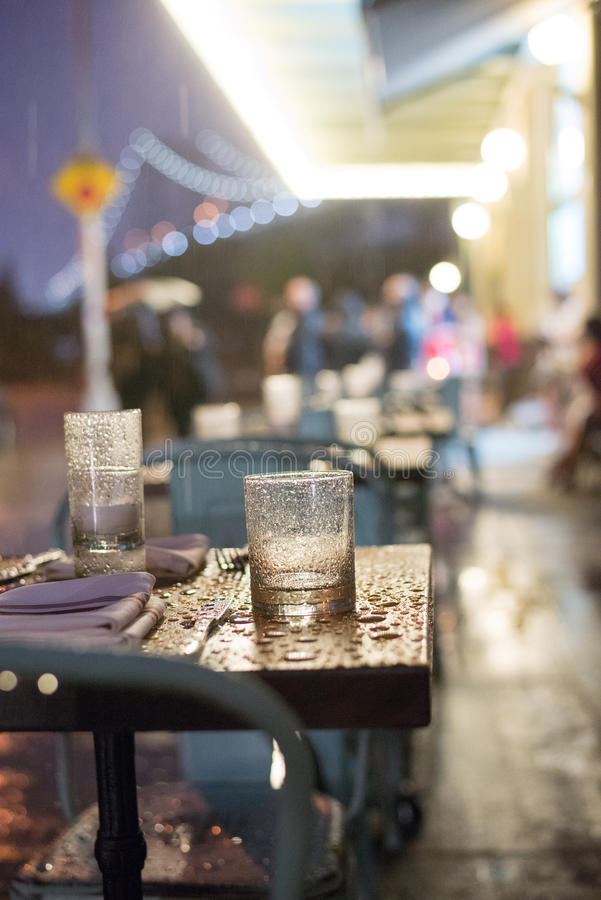 Rain. Restaurant table in front of bridge royalty free stock images