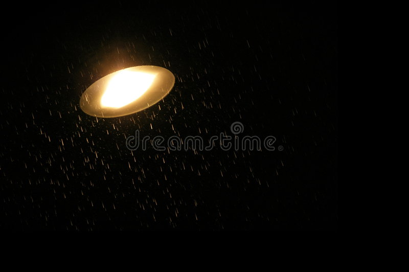 Rain and road lamp stock photography