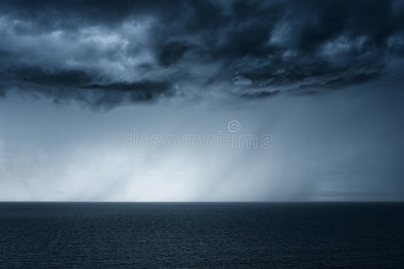 Rain on the sea with stormy clouds royalty free stock images