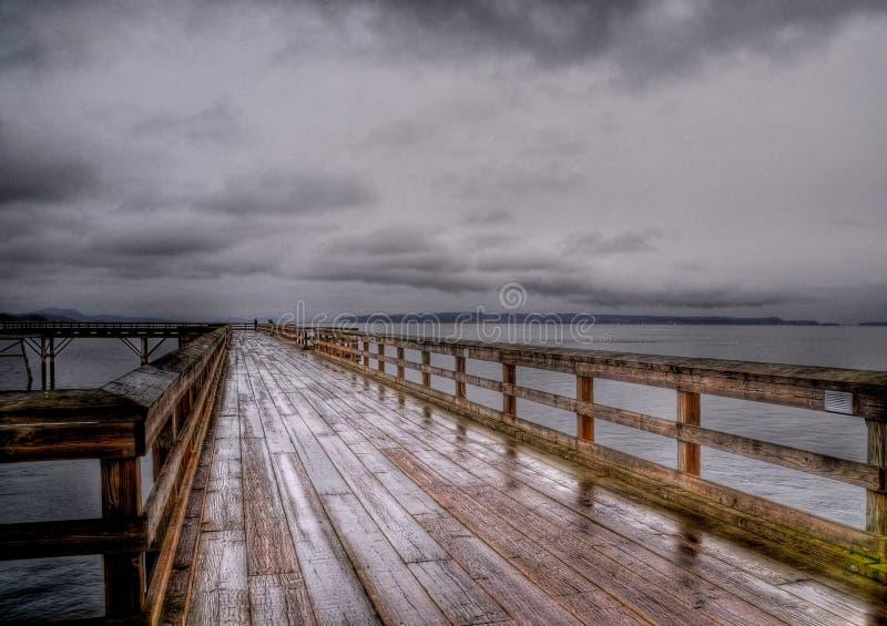 Rain on the Sidney pier stock image