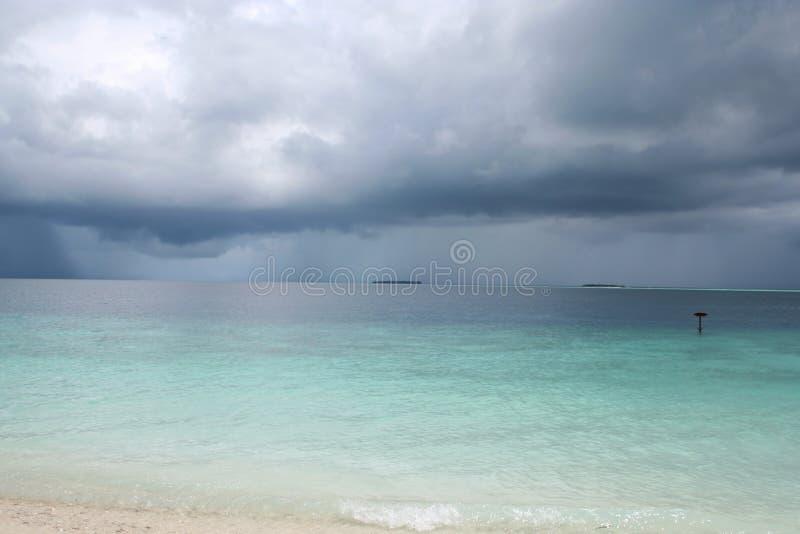 Rain storm above tropical sea royalty free stock photos